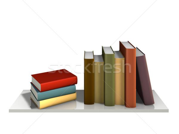 Cor livros em pé parede prateleira de livros papel Foto stock © reticent