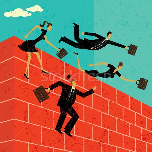 Saltando parede de tijolos pessoas de negócios pessoas parede Foto stock © retrostar
