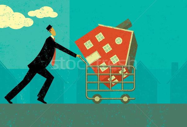 Compras casa homem caminhada carrinho de compras Foto stock © retrostar