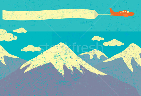 Airplane advertising in the mountains Stock photo © retrostar