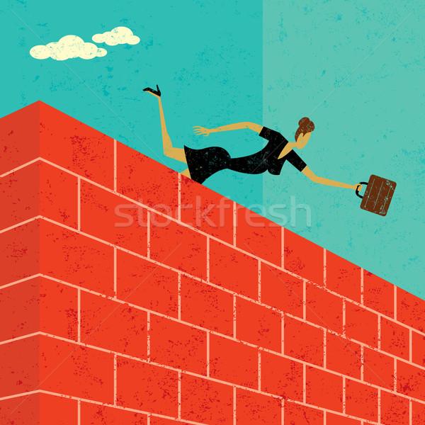 Skoki murem kobieta interesu cel kobieta ściany Zdjęcia stock © retrostar