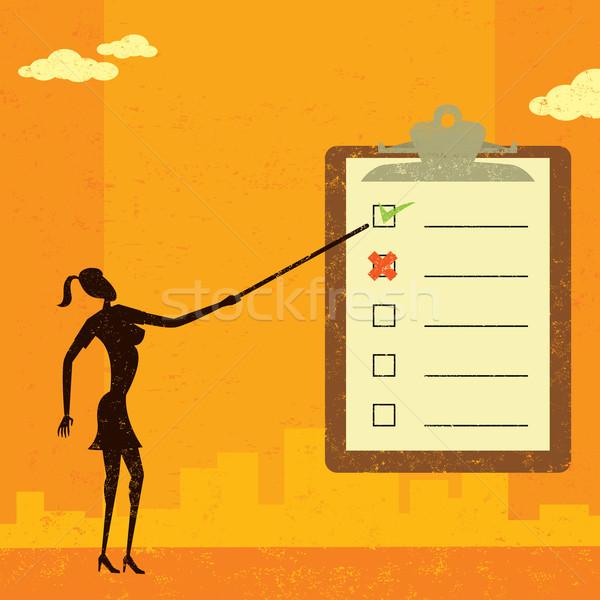 Examining a checklist Stock photo © retrostar