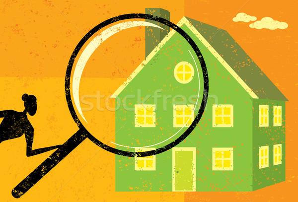 Maison femme regarder loupe maison Photo stock © retrostar