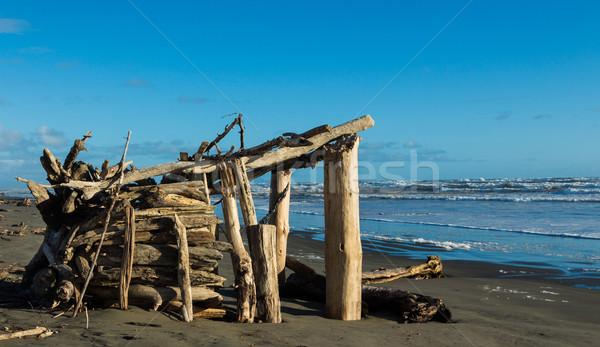 Praia abrigo fora mar areia arquitetura Foto stock © rghenry