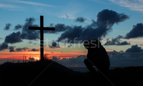 Sunsetting Praying Man Cross Stock photo © rghenry