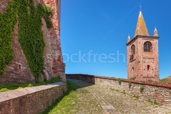 Paved walkway between brick wall and bell tower. Stock photo © rglinsky77