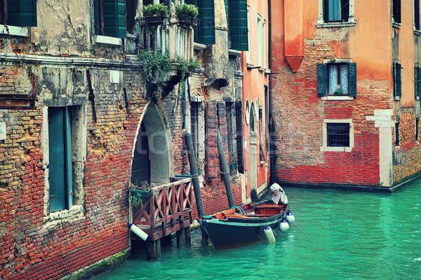 Boat and old brick house in Venice, Italy. Stock photo © rglinsky77