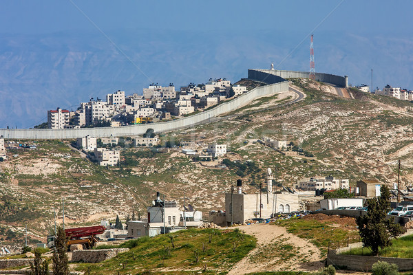 Palestinian town behind separation wall in Israel. Stock photo © rglinsky77