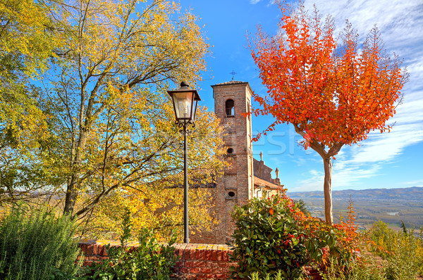 Old belfry among autumnal trees in Piedmont, Italy. Stock photo © rglinsky77