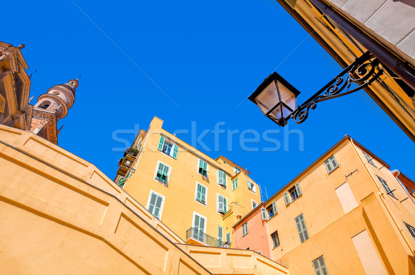 Yellow and orange buildings under blue sky in Menton. Stock photo © rglinsky77