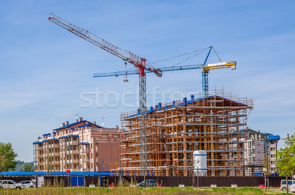 Cranes and new modern buildings. Stock photo © rglinsky77