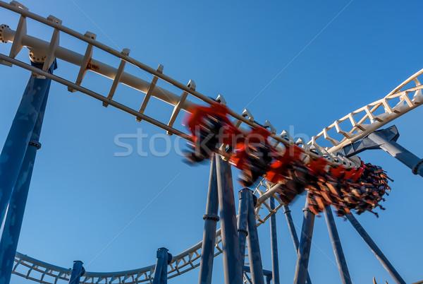 Montanha-russa parque blue sky céu vermelho acelerar Foto stock © rglinsky77