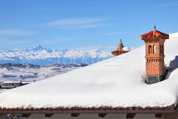 Red chimney on snowy roof. Piedmont, Italy. Stock photo © rglinsky77