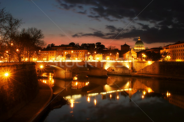 Tiber river and night illuminated Vatican city at evening. Stock photo © rglinsky77