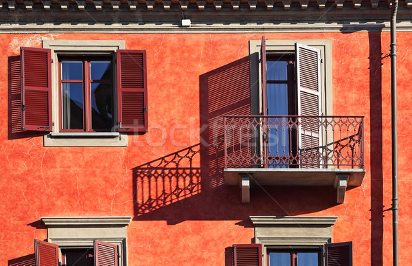 Balcony and windows with shutters cast shadow. Stock photo © rglinsky77