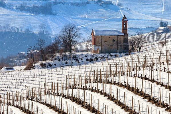 Parish church on snowy hill. Stock photo © rglinsky77