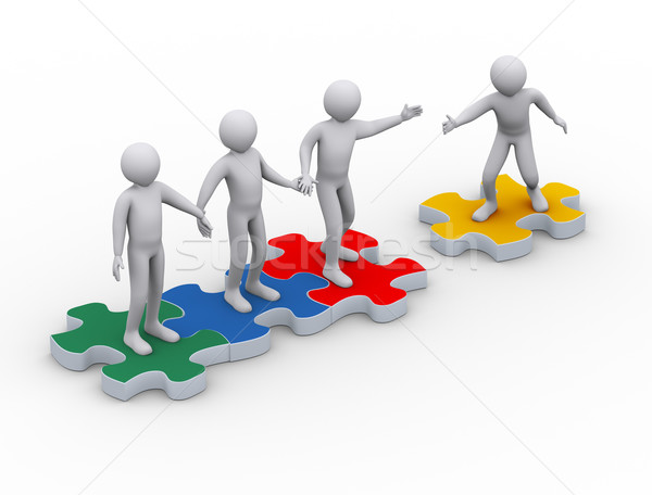 Stock photo: 3d man on puzzle joining team work
