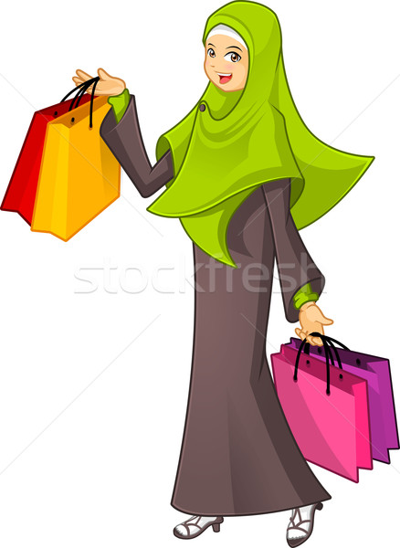 Stock photo: Muslim Woman Holding a Shopping Bag