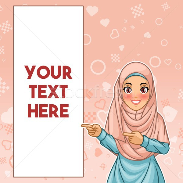 Muslim woman pointing finger to the right side at copy space Stock photo © ridjam