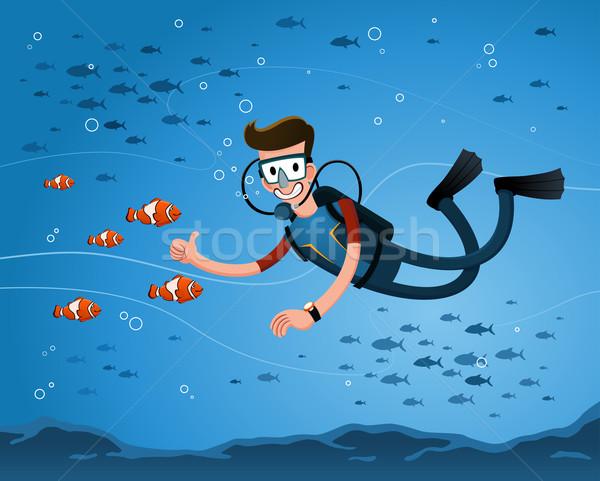 Сток-фото: создают · клоуна · рыбы · молодым · человеком · дайвинг · глубокий