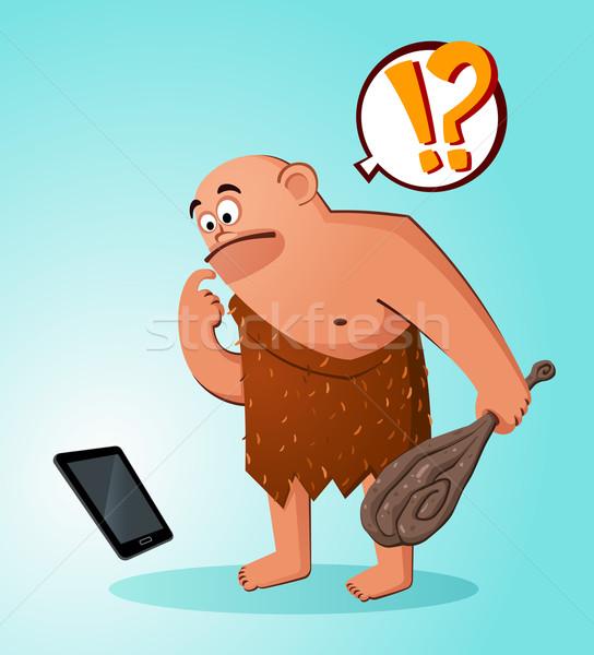 caveman found a gadget Stock photo © riedjal