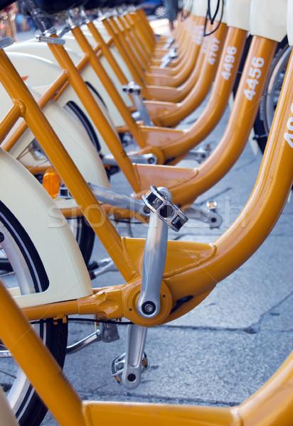 Nyilvános bicikli osztás park ökológiai város Stock fotó © rmarinello