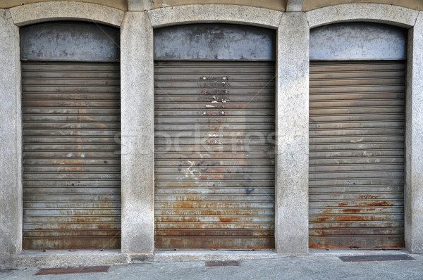 lowered rolling shutters of a disused shop Stock photo © rmarinello