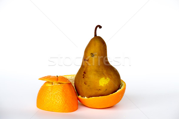 Pear inside an orange Stock photo © rmbarricarte