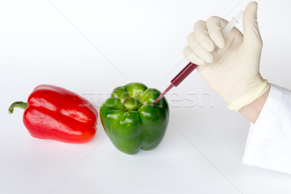 Stock photo: Injection into peppers