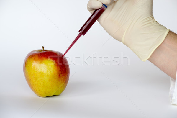 Injecting into an apple Stock photo © rmbarricarte