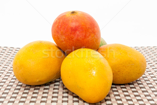Ripe yellow and red colored mango fruits on mat background Stock photo © robinsonthomas
