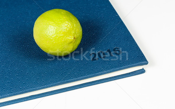 Lemon on blue diary Stock photo © robinsonthomas