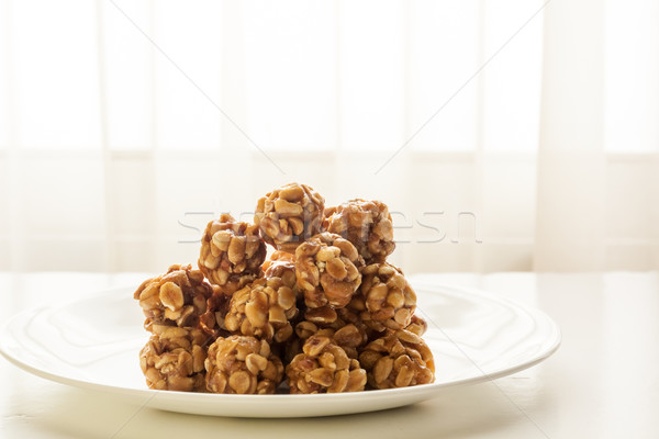Sweet peanut balls in a plate Stock photo © robinsonthomas