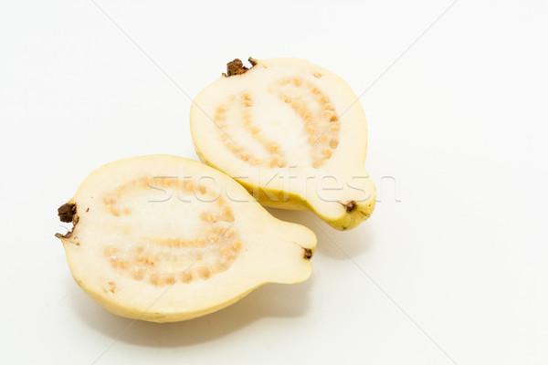 Meyve kesmek iki parçalar beyaz gıda Stok fotoğraf © robinsonthomas