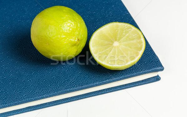 Slice of lemon on blue diary Stock photo © robinsonthomas