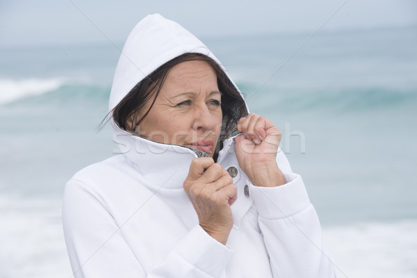 Woman freezing autumn at ocean Stock photo © roboriginal