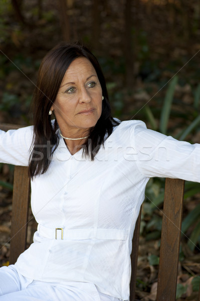 Lonely attractive mature woman sitting outdoor Stock photo © roboriginal