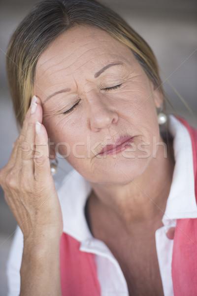Stressed mature woman headache closed eyes Stock photo © roboriginal