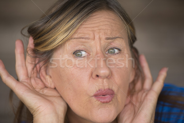 Woman listening surprised to sound and noises Stock photo © roboriginal