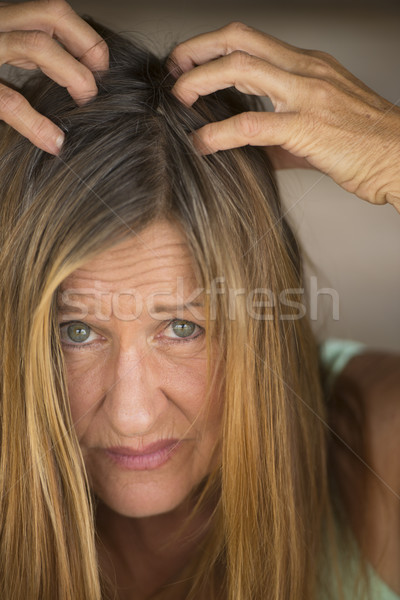 Stressed Woman tearing her hair  Stock photo © roboriginal