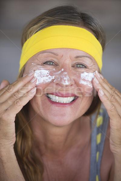 Bőrápolás testápoló mosolyog érett nő portré sportos Stock fotó © roboriginal