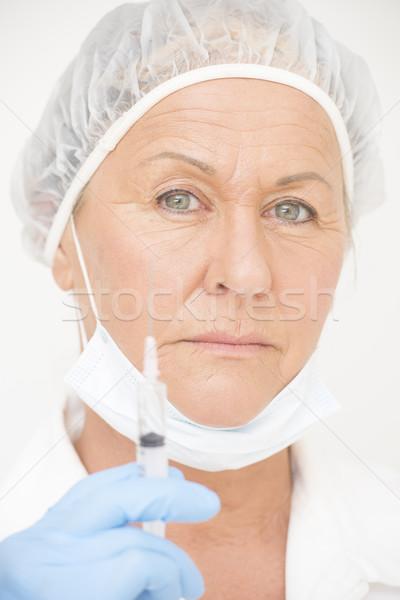 Professional hospital nurse with vaccine injection Stock photo © roboriginal