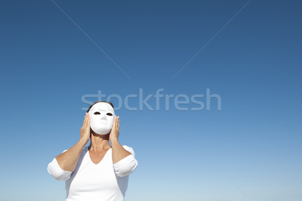 Woman behind mask sky background Stock photo © roboriginal