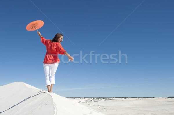 Beautiful woman balancing on sand dune rim Stock photo © roboriginal