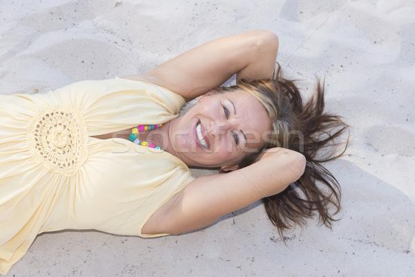 Hapyy retired woman relaxed at beach Stock photo © roboriginal