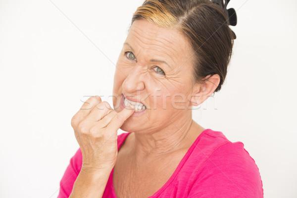 Nervoso donna mordere dito ritratto Foto d'archivio © roboriginal