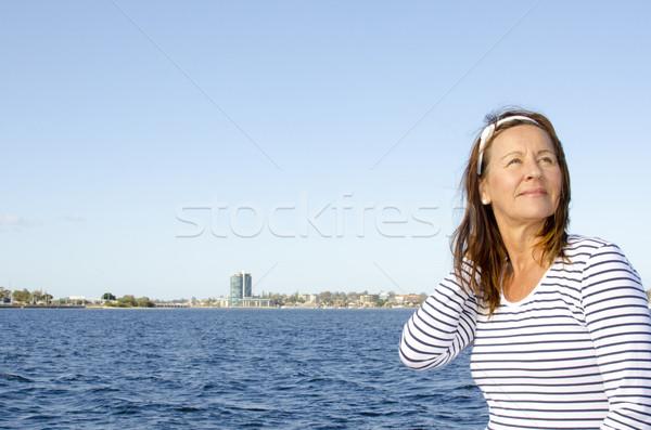 Active retired beautiful woman water background Stock photo © roboriginal