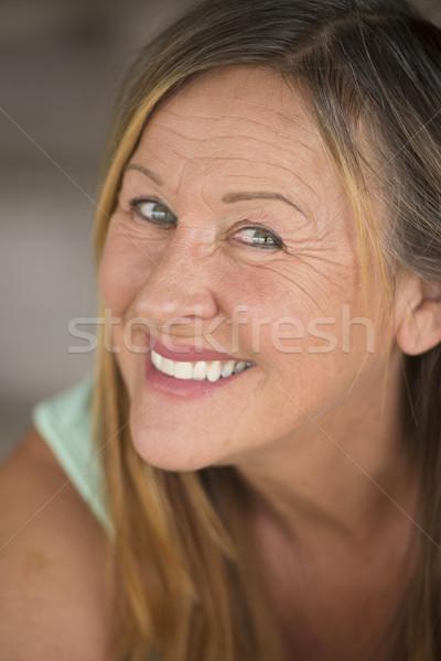 Active confident mature woman joyful Stock photo © roboriginal