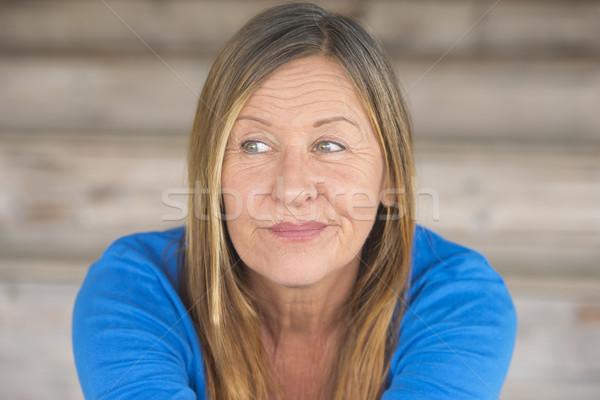 Shy happy smiling woman portrait Stock photo © roboriginal