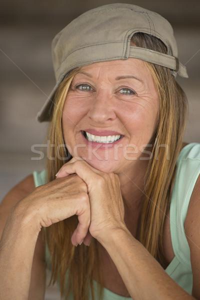 Active fit joyful mature woman sporty cap Stock photo © roboriginal